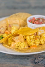 Breakfast tacos: Corn tortillas with tofu, potatoes, & queso. Served w/beans & pico.